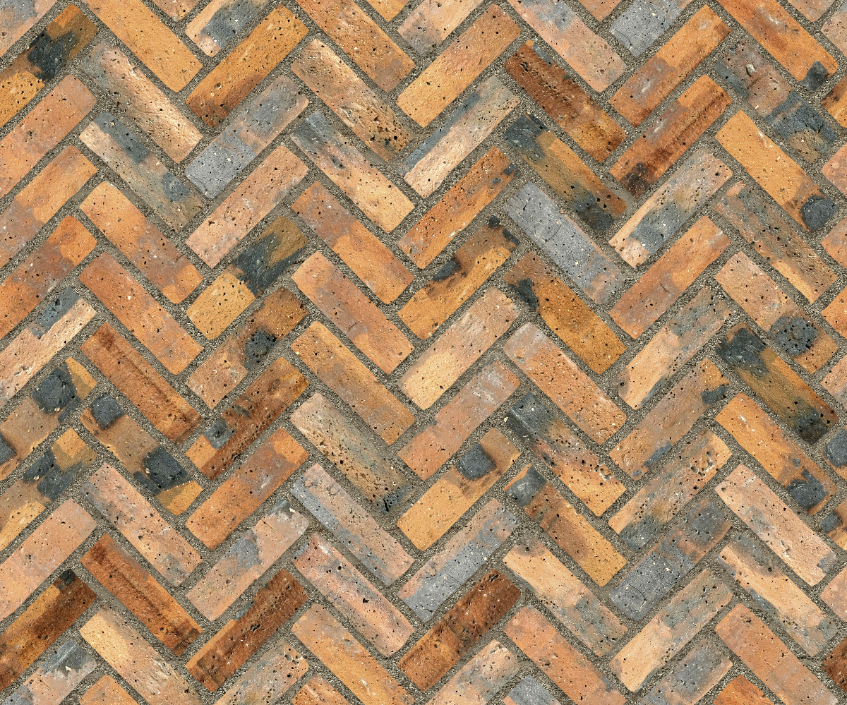 A seamless brick texture with industrial brick  arranged in a herringbone pattern