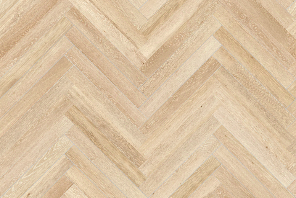 A seamless wood texture with ash boards arranged in a herringbone pattern