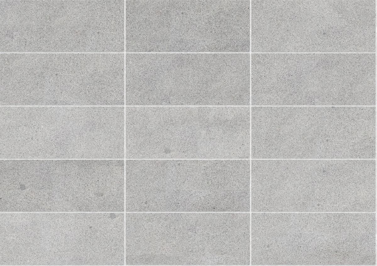 A seamless stone texture with granite blocks arranged in a stack pattern
