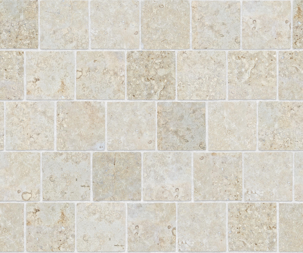 A seamless stone texture with limestone blocks arranged in a staggered pattern