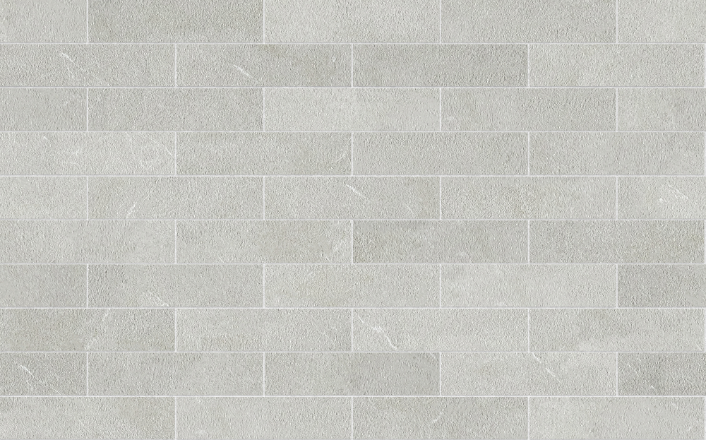 A seamless stone texture with limestone blocks arranged in a stretcher pattern
