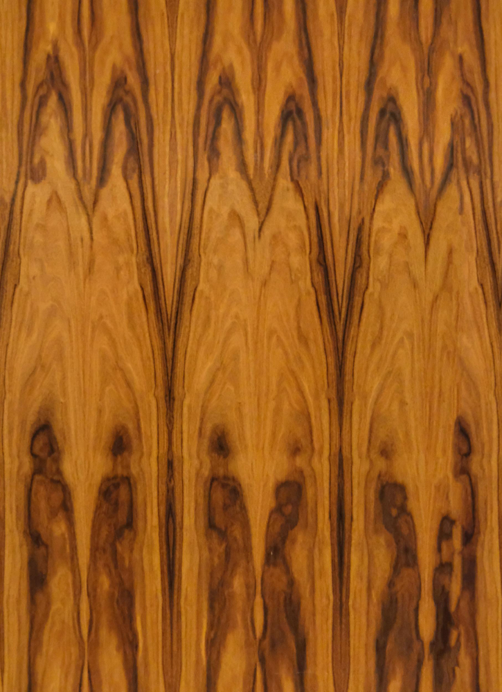 A seamless wood texture with wood veneer boards arranged in a none pattern